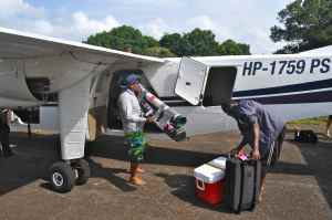 Unloading our tackle at the dirt airstrip at Las Perlas
