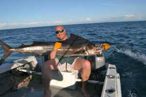 JOHN SHERVINGTON WITH HIS FIRST SAILFISH, CAUGHT OFF NOSY BE