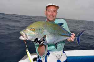 Terry Smith with bluefin trevally caught jigging