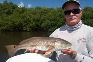 Capt. Bill Bassett with a redfish