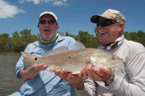 Andrew Leaves and Capt. bill Bassett with a nice Florida redfish