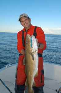 Robert Langford with a great cod caught on casting jig off Hitra