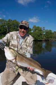 Capt Jim Wilcox with a good redfish