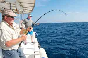 Bob Clements fighting a fish hooked jigging