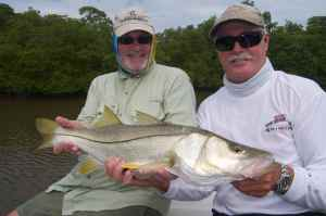 Andrew Leaves & Capt. Bill Bassett with a good snook