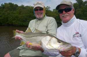 Andrew Leaves and Capt. Bill Bassett with a good Everglades snook, Bud n' Mary's group trip 2012