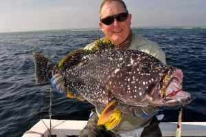 Derek 'Del' Elliot with a superb yellowfin grouper caught jigging
