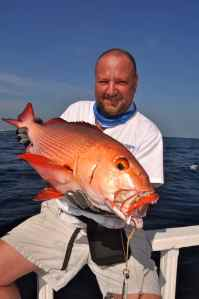 John Shervington with a stunning Bohur Snapper aka Red Bass, caught jigging