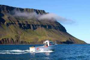 Self drive boat setting off from the north west fjords, Iceland
