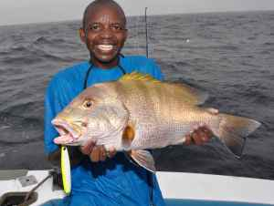Charo with a blubber lips snapper caught on a Shimano Butterfly jig