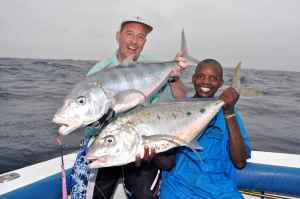 Terry Smith & Charo with a bludger & yellowspot trevally caught jigging