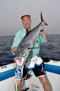 Terry with a king mackerel caught jigging