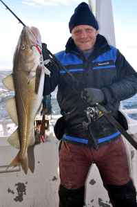 Cod caught on classic 400g stainless steel Norway pick