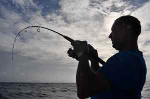Terry playing a good trevally hooked on light spinning tackle