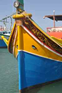 Traditional Maltese fishing boat, note the eyes on the bow, to ward off evil spirits