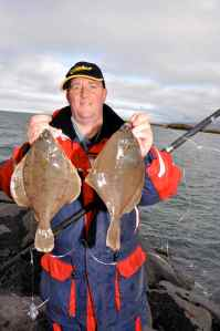 Steve Mason with a double shot of dabs caught from the shore in Iceland
