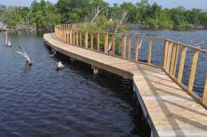 Access to the lake is via a boardwalk from which you can fish, but a small boat is also available