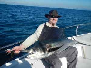 John Phillips with one of many sailfish caught during the week