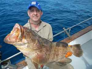 Simon Hughes with one of several decent grouper caught at the drop off