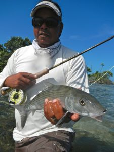 GEORGE HOLDS A TYPICAL BELIZE BONEFISH CAUGHT IN SKINNY WATER