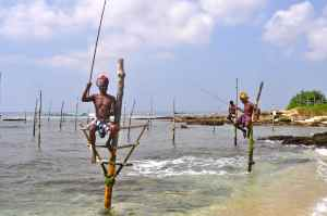 STILT FISHERMEN IN SOUTHERN SRI LANKA
