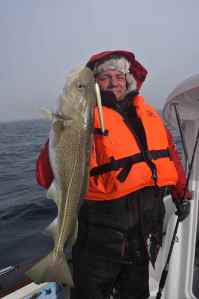 Chris Bett with one of many double figure cod, caught on a pick