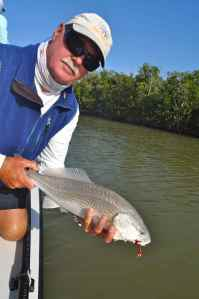 Capt Bill Bassett with a nice little back country redfish
