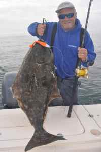 One of many halibut caught on Storm giant swim shads.