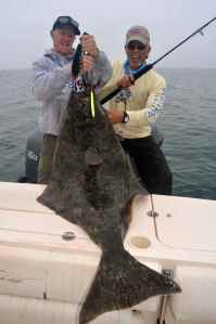 Doug & Trevor with a nice jig caught halibut.