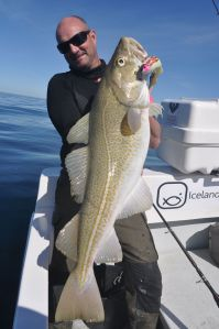 Kai Biala holds one of many big, shad caught cod.