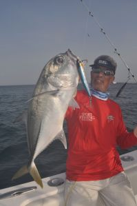 Doug Olander hold a good Horse Eye Jack caught on a Shimano Orca stick bait.