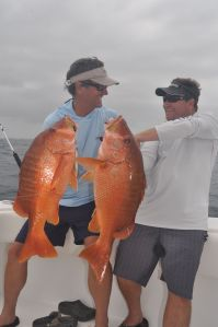 Bill Shedd & Marc Mills display a brace of bragging size Dog Snapper.