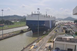 Gigantic japanese car carrier transiting the Miaflora Locks on the Panama Canal.