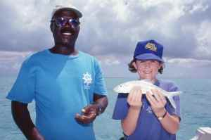 Amy holds one of her first bonefish.