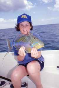 Amy holds a colourful Queen Trigerfish