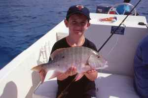 My son Luke holds a great mutton snapper.