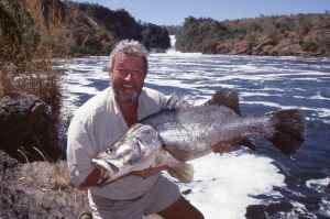 John Wilson hold a Nile Perch caught at The Devils Cauldron