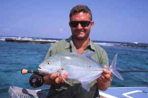 Andrew with a bluefin trevally caught fly fishing 2-Mile reef